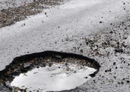 x-defects-asphalting-road